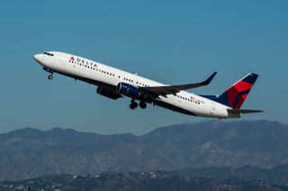 Delta Airlines Boeing 737-900 departs LAX