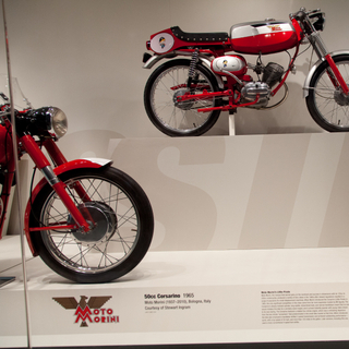 """Installation view of """"Moto Bellissima: Italian Motorcycles from the 1950s and 1960s"""""""