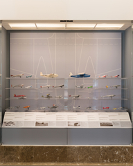 """Installation view of """"Aviation Evolutions: The Jim Lund 1:72 Scale Model Airplane Collection"""""""