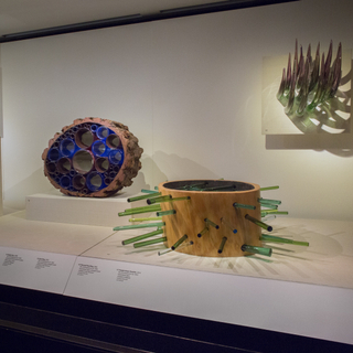 """Installation view of """"Studio Glass, The Art of Marvin Lipofsky, Richard Marquis, John Lewis and Elin Christopherson"""""""