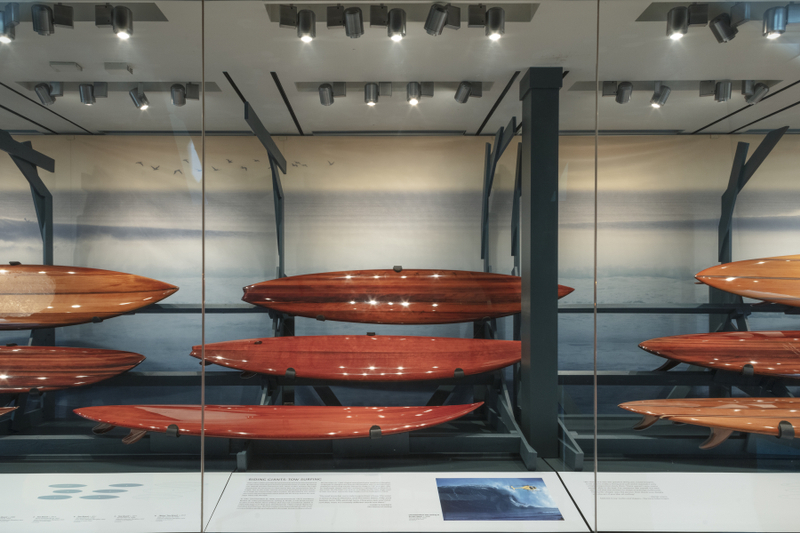 "Installation view of ""Reflections in Wood – Surfboards & Shapers"""