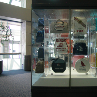 "Installation view of ""The Flight Bag: Icon of Air Travel"""