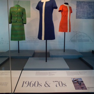 """Installation view of """"Fashion in Flight: A History of Airline Uniform Design"""""""