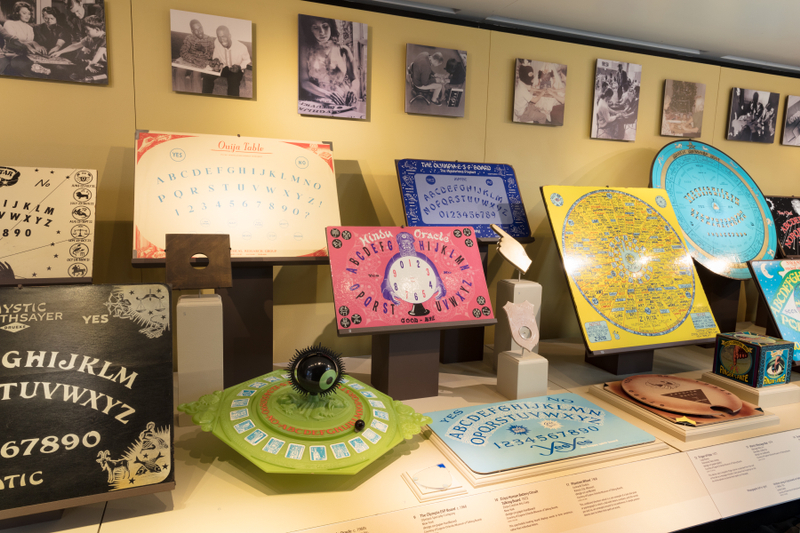 "Installation view of ""The Mysterious Talking Board: Ouija and Beyond"""