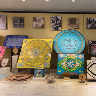 """Installation view of """"The Mysterious Talking Board: Ouija and Beyond"""""""