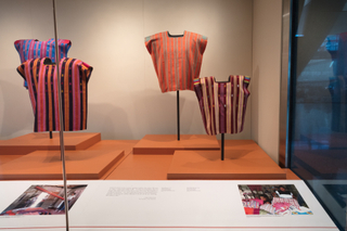 "Installation view of ""Empowering Threads: Textiles of Jolom Mayaetik"""