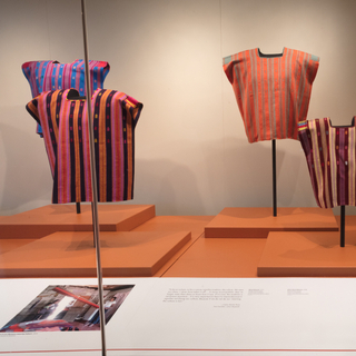 "Installation view of ""Empowering Threads: Textiles of Jolom Mayaetik"""