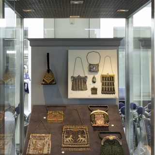 "Installation view of ""Essential Style: Antique and Vintage Handbags"""