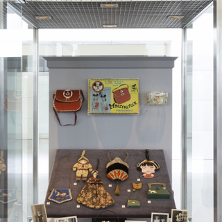 """Installation view of """"Essential Style: Antique and Vintage Handbags"""""""