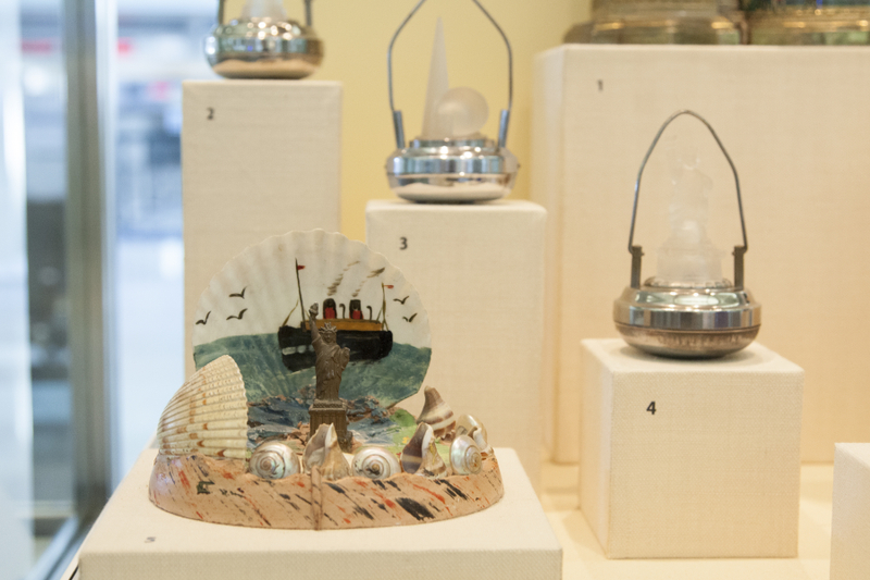 """Installation view of """"Souvenirs: Tokens of Travel"""""""