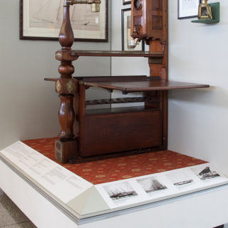 """Installation view of """"America's Cup, Sailing for International Sport's Greatest Trophy 1851-1937"""""""