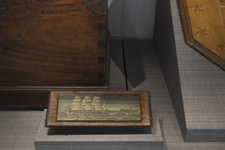 """Installation view of """"From Ship to Shore: Nautical Arts from the San Francisco Maritime National Historic Park"""""""