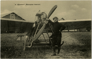 postcard: Henri Gournay standing in front of Hanriot monoplane in Reims