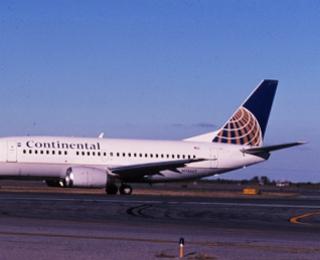 slide: Continental Airlines, Boeing 737-600, John F. Kennedy International Airport (JFK)