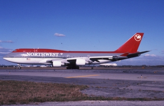 slide: Northwest Airlines, Boeing 747-400, John F. Kennedy International Airport (JFK)