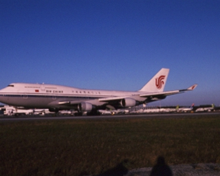 slide: Air China, Boeing 747-400, John F. Kennedy International Airport (JFK)