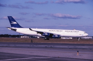 slide: Aerolineas Argentinas, Airbus A340-200, John F. Kennedy International Airport (JFK)