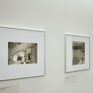 """Installation view of """"Above the Bay: The Aerial Photography of Stanley Page"""""""