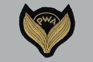 flight officer cap badge: PWA (Pacific Western Airways)