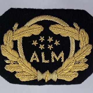 flight officer cap badge: Dutch Antillean Airlines (ALM)