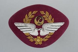flight officer hat badge: JAL (Japan Airlines)
