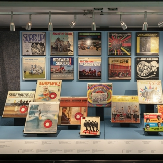 """Installation view of """"Surf's Up! Instrumental Rock n' Roll"""""""